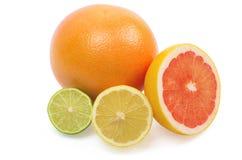 Image of a fresh whole lime, lemon and orange. On white Royalty Free Stock Images