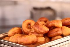 Image of freshly made donuts. The concept of food and service. royalty free stock image