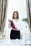 Image of friendly hostess posing in restaurant Royalty Free Stock Image
