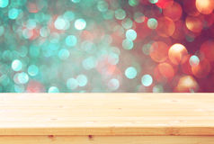 Image of front rustic table and colorfull bokeh lights background. Royalty Free Stock Images