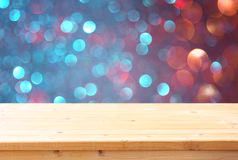 Image of front rustic table and colorfull bokeh lights background Royalty Free Stock Photos