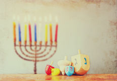 Image of front woodwn table and menorah un the background. hanukkah concept Royalty Free Stock Image