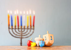 Image of front woodwn table and menorah un the background. hanukkah concept. Stock Images