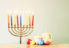 Image of front woodwn table and menorah un the background. hanukkah concept Royalty Free Stock Photos