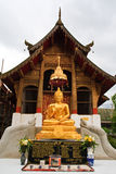 Image in frot of church. Buddha image and chuch of Wat Sampow in Chiang Mai, Thailand Stock Photos