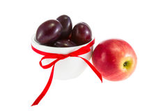 Image of fruit apples and plums in a bowl Royalty Free Stock Images