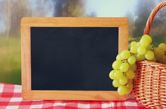 Image of fruit next to empty blackboard for copy space. Symbols of jewish holiday - Shavuot Royalty Free Stock Photos