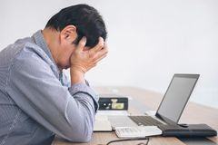 Image of Frustrated stressed business man and graph business wit royalty free stock photos