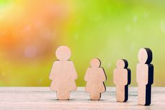 The image of a full family. Wooden figures stock photography