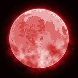 Image of the full moon. Image of the month in red with clouds Stock Photo