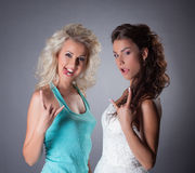 Image of funny bride and her friend posing faces Stock Image