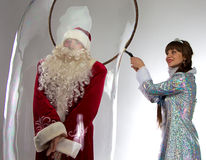 Image funny Santa and snow maiden with soap bubble Stock Photography