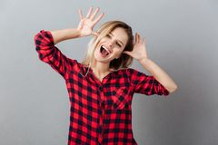 Funny young blonde woman standing isolated Stock Photography