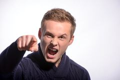 Image of furious young man shouting Royalty Free Stock Photos