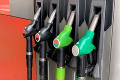 Gas station with filling hoses close-up. Image of gas station with filling hoses close-up royalty free stock images