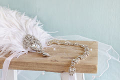 Image of gatsby style diamond head decoration. With feathers on toilet table stock photos
