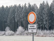 Image of German street sign in winter landscape royalty free stock image