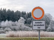 Image of German street sign in winter landscape stock photos