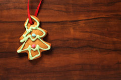 Image of gingerbread Christmas tree cookie over brown wooden tex Royalty Free Stock Photos