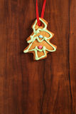 Image of gingerbread Christmas tree cookie over brown wooden tex Stock Photography