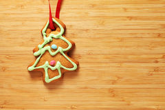 Image of gingerbread Christmas tree cookie over wooden texture Stock Photos