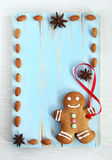Image of Gingerbread man on blue vintage cutting board Stock Photography