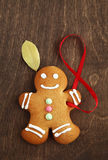 Image of Gingerbread man on brown cutting board Stock Images