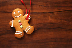 Image of Gingerbread man cookie over brown wooden texture Stock Photo