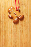 Image of Gingerbread man cookie over wooden texture Stock Photo