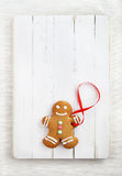 Image of Gingerbread man on white vintage cutting board Stock Photos