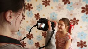 Image of the girl in the camera. During a photo shoot stock video footage
