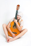 The image of the girl with a guitar Royalty Free Stock Photography