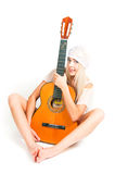 The image of the girl with a guitar Stock Image