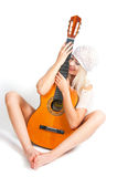 The image of the girl with a guitar Stock Images