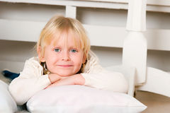 Girl lying on a floor Stock Image