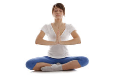 Image of a girl practicing yoga. On white Stock Image