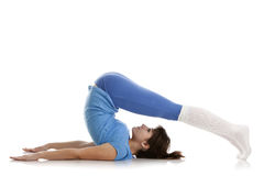 Image of a girl practicing yoga. On white Stock Photos