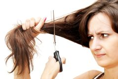 The image of a girl who cuts her hair Royalty Free Stock Photos