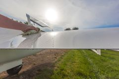 Image glider on the green lawn of the airfield. Royalty Free Stock Photo