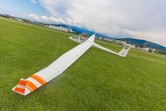 Image glider on the green lawn of the airfield. Stock Image