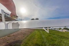 Image glider on the green lawn of the airfield. Royalty Free Stock Photos