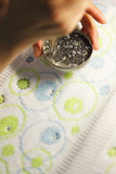 Image of gluing sequins to tissue Stock Photos
