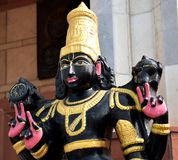 Image of a god in black at an ISKCON temple in Delhi stock images
