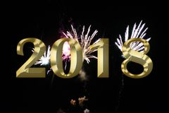 Gold figures 2018 on the background of the festive fireworks. Image of gold figures 2018 on the background of the festive fireworks Stock Image