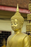 Image of golden buddha statue in temple in province tak. Royalty Free Stock Image