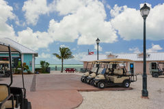 Image of golf carts near some light posts. Image of some gulf carts on a sunny day Royalty Free Stock Photos