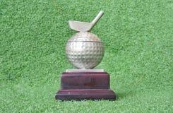 Image of golf medal or trophy