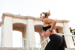 Gorgeous strong young sports woman running royalty free stock image