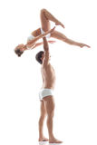 Image of graceful acrobats - strong man holds girl Royalty Free Stock Photo