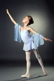 Image of graceful little dancer on gray backdrop Royalty Free Stock Images